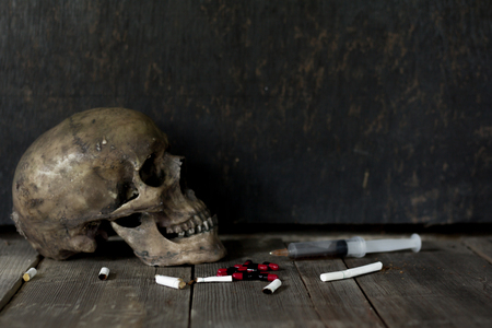 Human skull death due to drug addiction, anti-narcotic ideas.