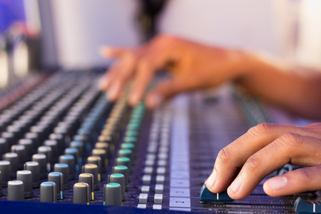 hand adjusting volume sound of mixer, sound and music concept