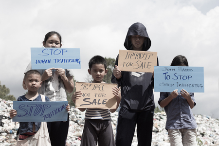 Standing childs holding a sign, anti-trafficking, stopping violent acts against children, stopping child labor. Stock Photo - 101267796