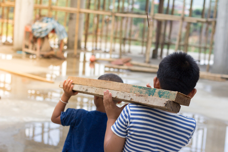 Children are forced to work as construction worker. Violence children and trafficking concept. Anti-child labor, rights day on December 10.