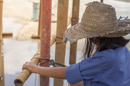 A child forced to work as construction worker. Violence children and trafficking concept. Anti-child labor, rights day on December 10. Stock Photo