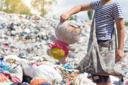 Poor children collect old dolls from garbage dumps, the concept of pollution and the environment,World Environment Day Stock Photo