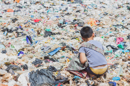 Children find junk for sale and recycle them in landfills, the lives and lifestyles of the poor, The concept poverty, child labor and human trafficking.