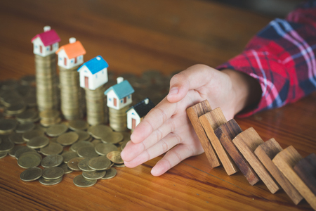 The concept of risk of investing money. security of property rights. protection of investments and deposits. family, home. Stock Photo