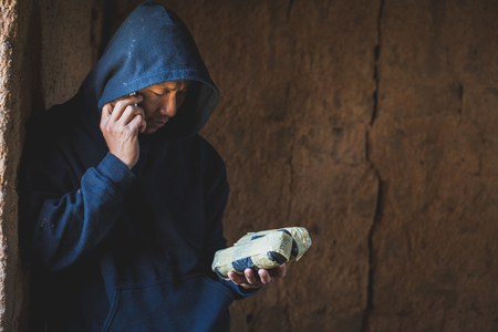 Drug dealers use the phone to contact the customer, drug trafficking, crime, addiction and sale, copy space, The concept of buying and selling drugs.