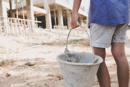 child labor work in the construction site, Against child labor, Poor children, construction work, Violence children and trafficking concept 版權商用圖片
