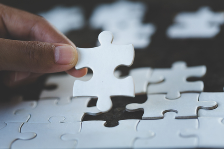Hand put the last piece of jigsaw puzzle to complete the mission, Business solutions, success and strategy concept Standard-Bild - 114538198
