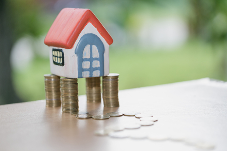 Mini house on stack of coins,Money and house,  Mortgage, Savings money for buy house and loan to business investment for real estate concept. Invesment and Risk Management. Reklamní fotografie