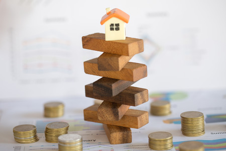 The concept of risk of investing money. security of property rights. protection of investments and deposits. family, home. Stock Photo - 114537357