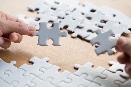business woman hands connecting couple jigsaw puzzle piece against sunrise, Business solutions, target, success, goals and strategy concepts Standard-Bild - 116346352