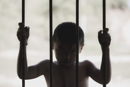 Children are stressed because they are trapped in a steel cage.The concept of violence against children.