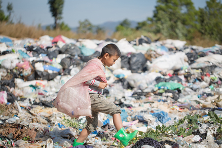 Poor children collect garbage for sale because of poverty, Junk recycle, Child labor, Poverty concept, human trafficking, World Environment Day, Banco de Imagens