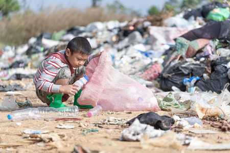 Poor children collect garbage for sale because of poverty, Junk recycle, Child labor, Poverty concept, human trafficking, World Environment Day, Banque d'images