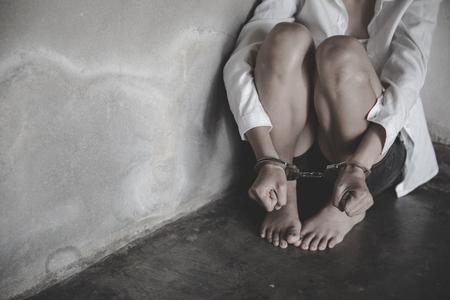 The slave girl was handcuffed and kept. Women violence and abused concept, Imprisonment, Female prisoner,  human trafficking Concept, international women's day.