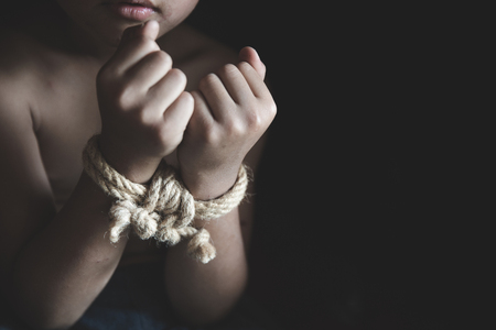 Victim boy with hands tied up with rope in emotional stress and pain, kidnapped, abused, hostage, Stop abusing violence, Children violence and abused concept Stock Photo