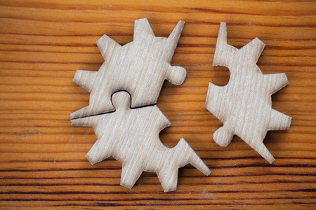 Wooden jigsaw puzzle On Wooden Desk, team business concept