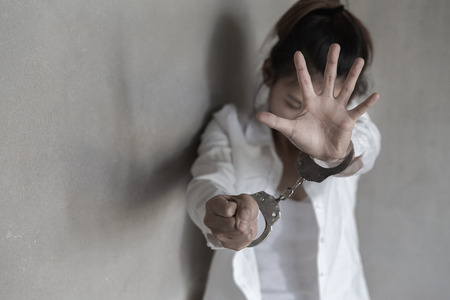 The slave girl was handcuffed and kept . Women violence and abused concept, Human rights Day concept. human trafficking Concept, international womens day.