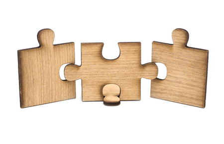 Three pieces of wooden jigsaw are connected together isolated on white background. concept of connecting Banque d'images