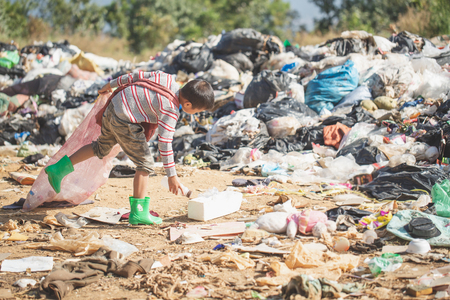 Poor children collect garbage for sale because of poverty, Junk recycle, Child labor, Poverty concept, human trafficking, World Environment Day, Stock Photo - 123149631
