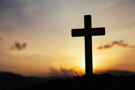 Jesus Christ cross. Easter, resurrection concept. Christian wooden cross on a background with dramatic lighting.