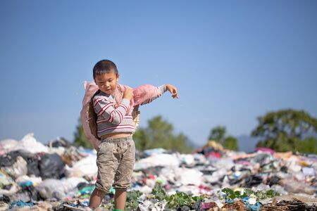 Poor children collect garbage for sale because of poverty, Junk recycle, Child labor, Poverty concept, World Environment Day, Stock Photo