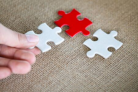 Hand connect white and red jigsaw parts with word problem & solution. symbol of association and connection. business strategy. Teamwork concept.