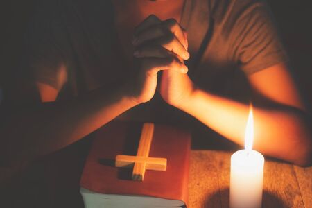 Hands praying on a Holy Bible, spirituality and religion, Religious concepts