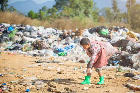 Children find junk for sale and recycle them in landfills, the lives and lifestyles of the poor, Child labor, Poverty and Environment Concepts