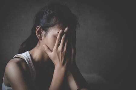 despair rape victim waiting for help, Stop sexual harassment and violence against women, rape and sexual abuse concept. Stock Photo