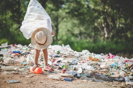 Poor children collect garbage for sale and recycle them in landfills, the lives and lifestyles of the poor, Child labor, Poverty and Environment Concepts Stock Photo
