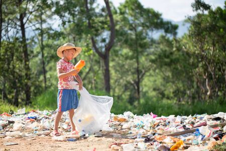 Poor children collect garbage for sale because of poverty, Junk recycle, Child labor, Poverty concept, human trafficking, World Environment Day, Stock Photo