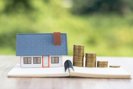 concept of saving money for house, Savings money for buy house and loan to business investment for real estate concept. Investment and Risk Management.