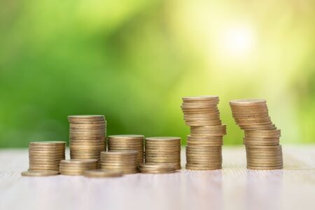 Coin stacks on a green background, Business Growth concept, saving money, Financial risk.
