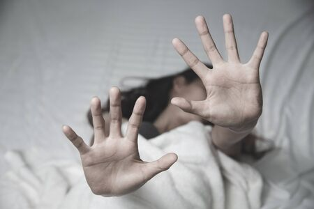 Woman's hand extended signaling to stop useful to campaign against violence, gender or discrimination