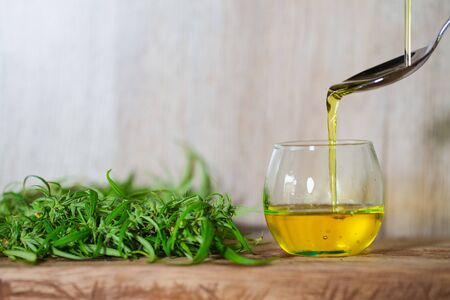 Pouring hemp oil into spoon.medical marijuana concept, CBD cannabis OIL, Herbs for alternative medicine. medical marijuana oil concept