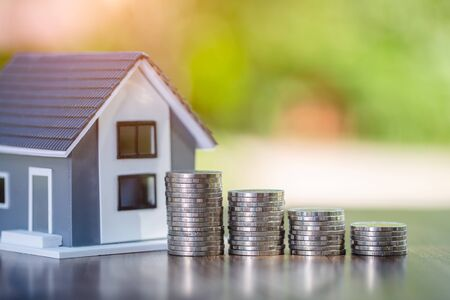 planning savings money of coins to buy a home, concept for property ladder, mortgage and real estate investment. for saving or investment for a house Stockfoto