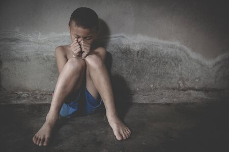 The child is tied up with a rope, stop child violence, child labor, human rights, human trafficking 免版税图像