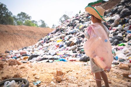 Children are junk to keep going to sell because of poverty, World Environment Day, Child labor,  human trafficking, Poverty concept