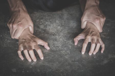 Man's hand holding a woman hand for rape and sexual abuse,   problem or Social issues concept. Foto de archivo
