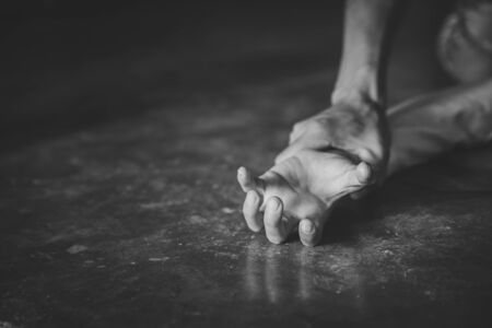 Man's hand holding a woman hand for rape and sexual abuse,   problem or Social issues concept.black and white picture.