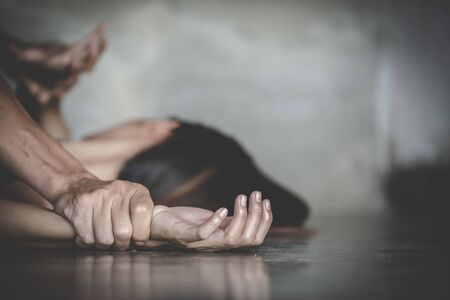 Close up of man hands holding a woman hands for rape and sexual abuse.