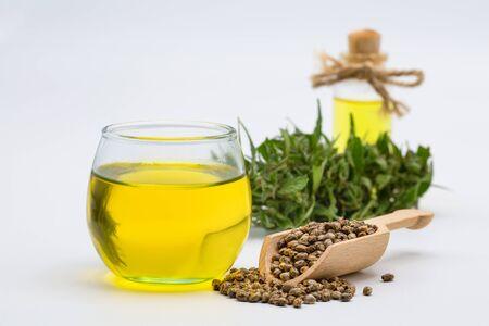 CBD cannabis oil. Hemp oil and hemp seed isolated on white background. Healthy cannabis oil.