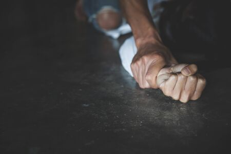 Close up of man hands holding a woman hands for rape and sexual abuse concept, Wound domestic violence rape, sexual assault, stop violence against women, human trafficking. 版權商用圖片