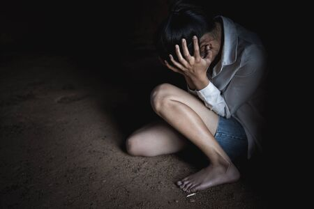 Young depressed woman, domestic and rape violence,beaten and raped sitting in the corner, Domestic violence.