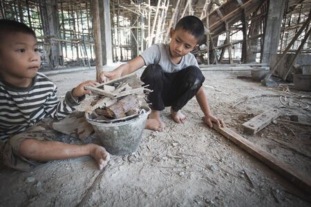 Concept of poverty and child labor, Children who are working on construction sites, Against child labor, Poor children, construction work, Violence children and trafficking concept