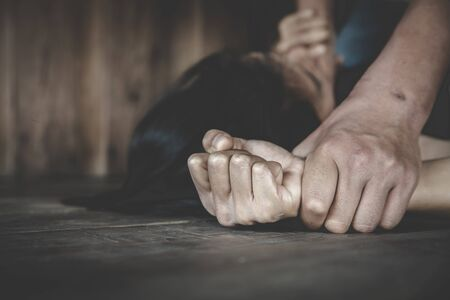 Man hand holding a woman hand for rape and sexual abuse. Woman victim of domestic violence and abuse.