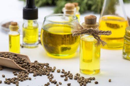 Hemp seeds and hemp oil, CBD cannabis oil extract, marijuana alternative herbal medicine concept.