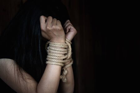 The slave woman is tied with a rope, stop acts of violence against women, rape and sexual abuse, human trafficking,
