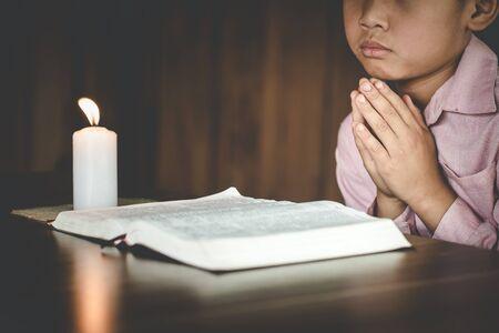 Religious asian buddhist boy praying. boy buddhist disciple meditating,Pay respect, Pray to God,