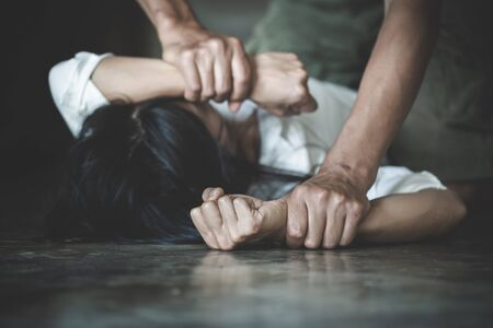 Man hands holding a woman hands for rape and sexual abuse concept. Stop sexual harassment and violence against women. International Women's Day.